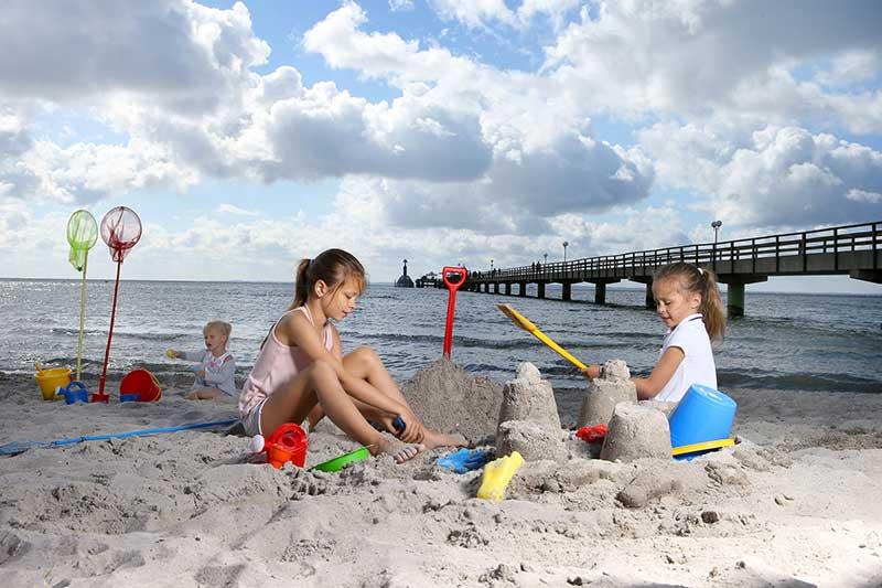 Strand spielen